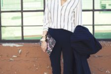 15 navy pants, a striped shirt, white heels and a striped navy coat