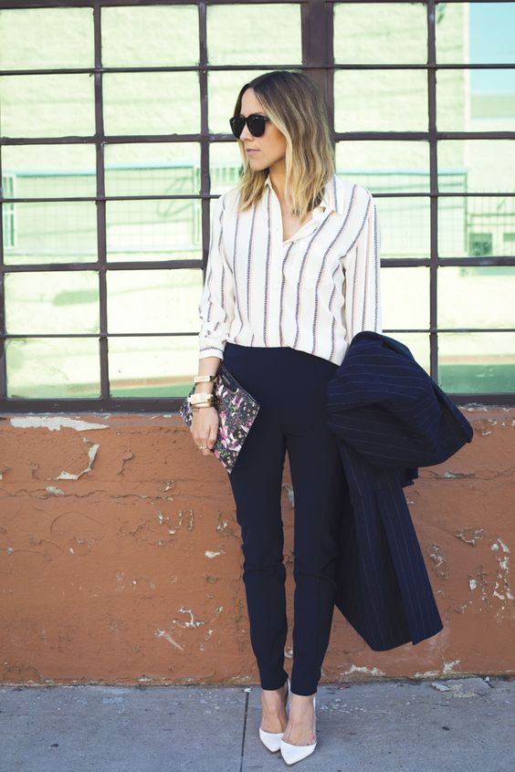navy pants, a striped shirt, white heels and a striped navy coat