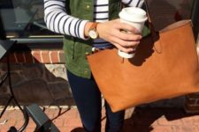 15 navy skinnies, a striped long-sleeve, an olive green vest and tan flats