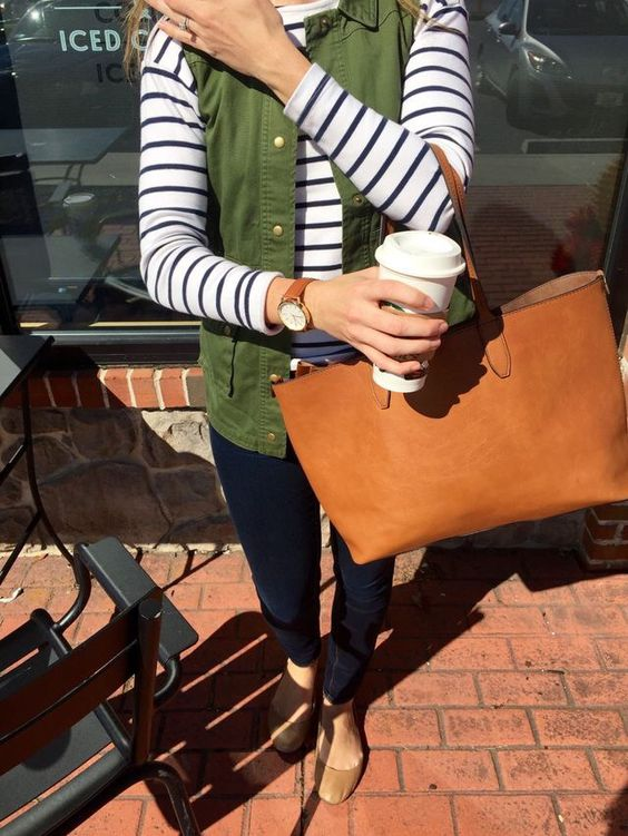 navy skinnies, a striped long sleeve, an olive green vest and tan flats