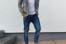 15 ripped blue jeans, white chucks, a white tee and a grey jacket