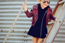 16 black zip dress, a red leather jacket and black sneakers
