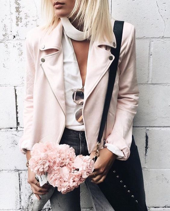 blush leather jacket, a white top and grey jeans