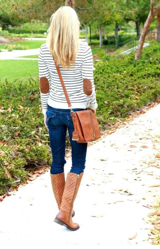 jeans, a striped sweatshirt and high brown boots