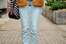 16 jeans, graphic T-shirt, long mustard cardigan, Converse, a striped bag