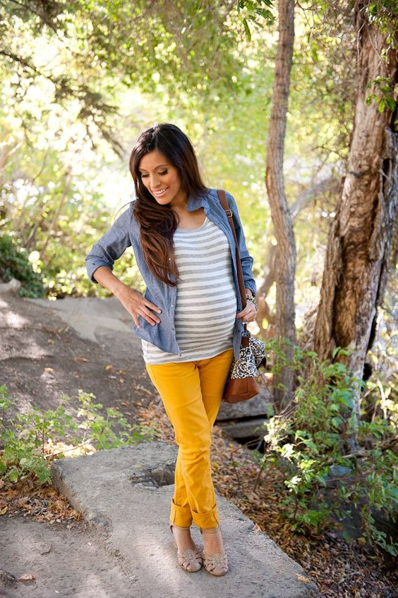 mustard trousers, a striped shirt, nude boots and a chambray shirt