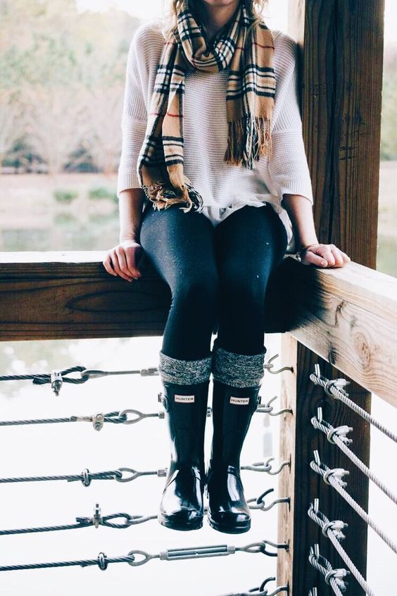 navy jeans, a white sweater, a plaid scarf, leg warmers