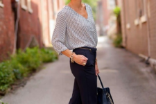 16 navy trousers, a printed blouse, gold flats