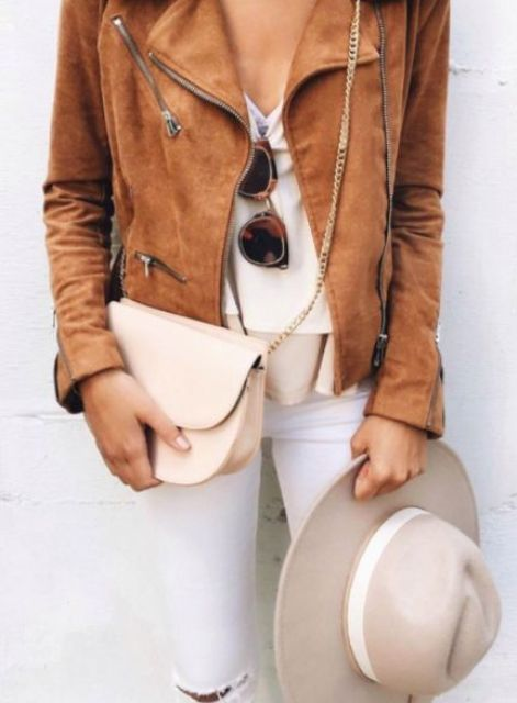 brown leather jacket, white jeans, a white top and a nude hat