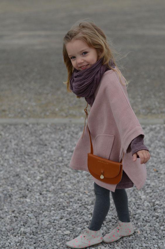 grey leggings, a pink coat and polka dot chucks