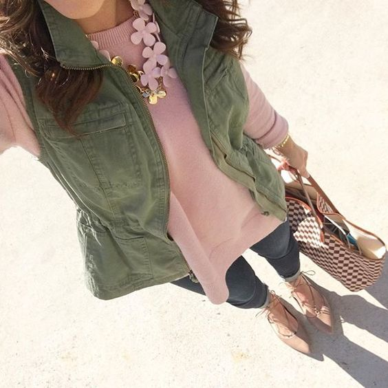 pink sweater, blue jeans, nude flats, an olive green vest