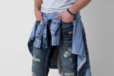 17 ripped blue jeans, a grey t-shirt, a plaid shirt and grey chucks