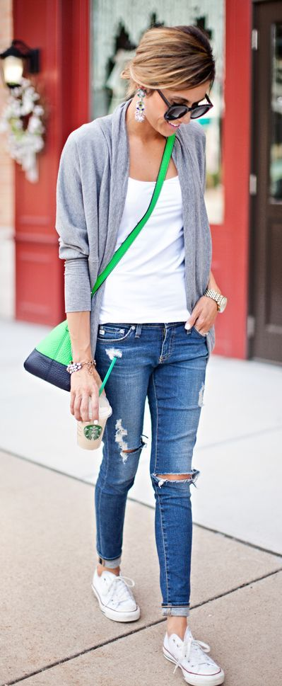 ripped jeans, a white top, a grey cardigan and white Converse