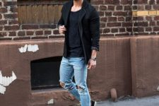 17 ripped rolled up jeans, a black t-shirt and a black jacket