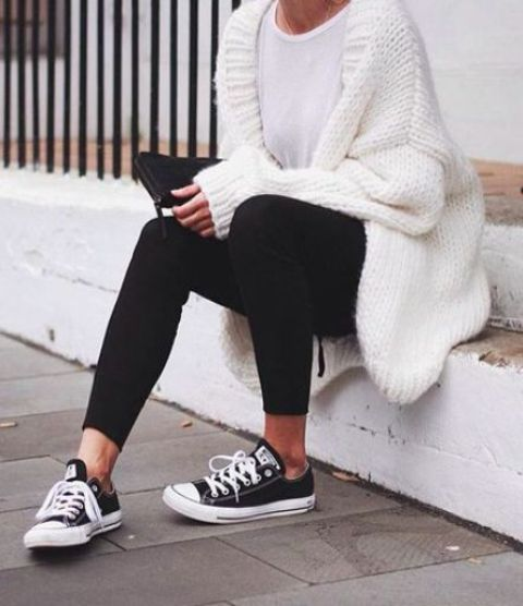 white chunky knit cardigan, a white tee and black leggings