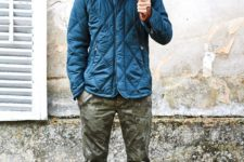 18 a bright blue puffer jacket, camo trousers and cognac boots