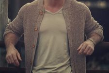 18 green sporty trousers, a grey tee and a brown cardigan