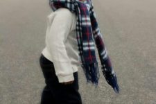 18 navy jeans, a white sweatshirt, ocher boots, a plaid scarf