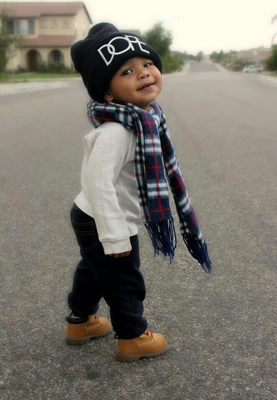 navy jeans, a white sweatshirt, ocher boots, a plaid scarf