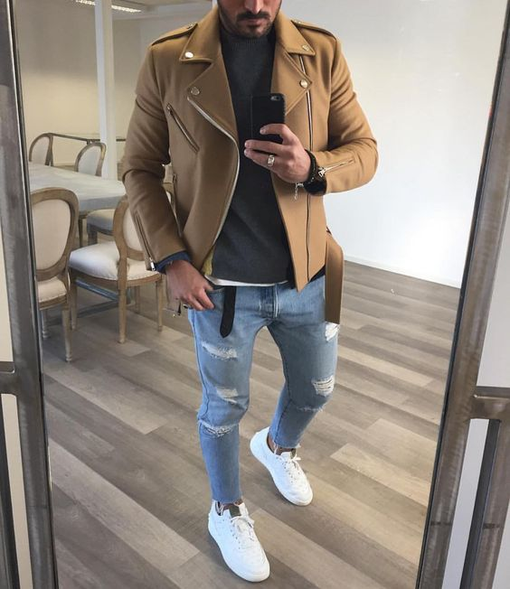 ripped blue denim, a black jersey, white chucks and an ocher felt jacket
