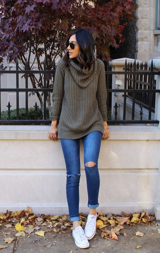 ripped jeans, a green grey sweater