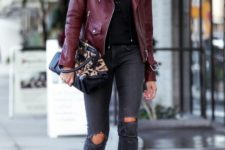 19 burgundy jacket, ripped grey jeans, a black lace up top and lace up heels