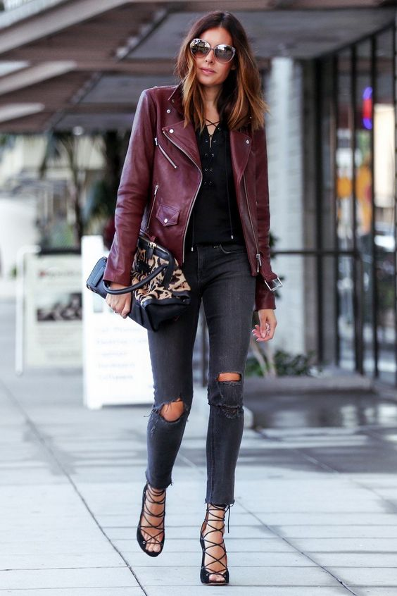 burgundy jacket, ripped grey jeans, a black lace up top and lace up heels