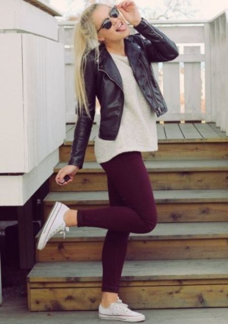 burgundy jeans, a white shirt, white Converse and a black leather jacket