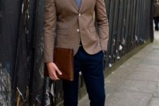 19 navy trousers, a brown blazer, a shirt and a tie, burgundy shoes