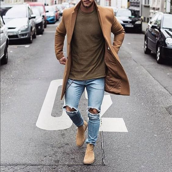 ripped jeans, a brown t shirt, nude boots and a camel coat
