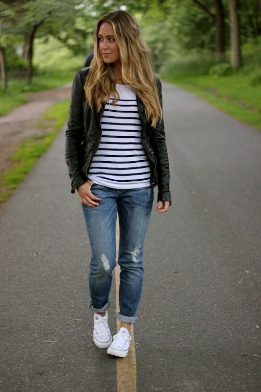 ripped jeans, a striped tee, white Converse and a black leather jacket