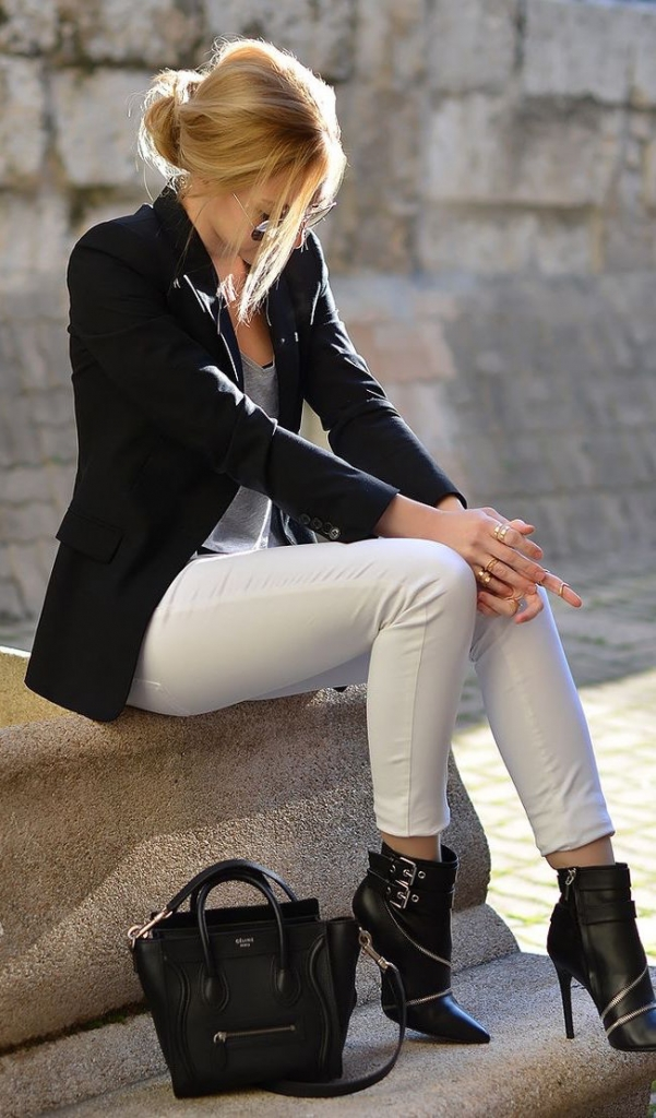 white trousers, a black blazer, a grey top and black ankle boots