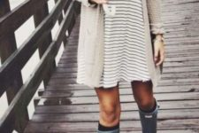 20 a striped dress, an ivory cardigan, rain boots