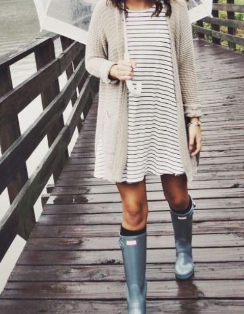 a striped dress, an ivory cardigan, rain boots