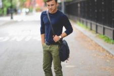 20 army green pants, a navy jersey and blue Converse