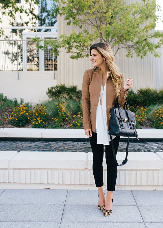 black leggings, a white shirt and a tan leather jacket