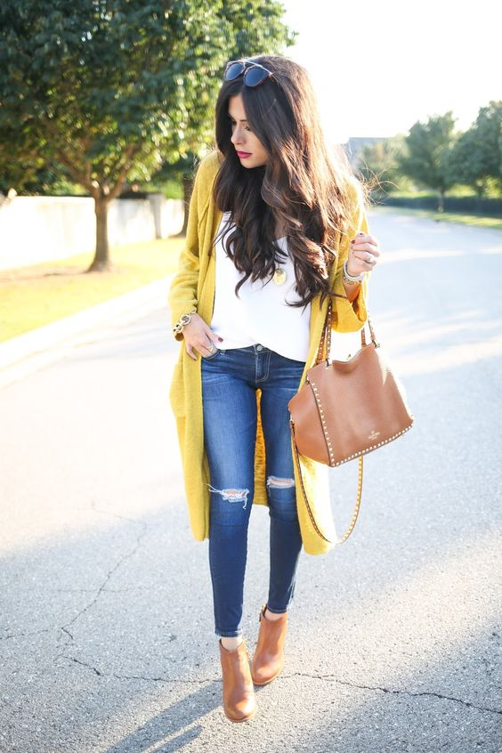 blue jeans, a white t-shirt, a mustard cardigan and tan boots