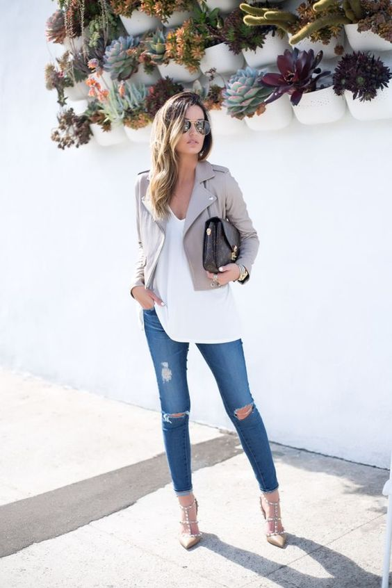 cropped grey jacket, ripped blue jeans, a long white top
