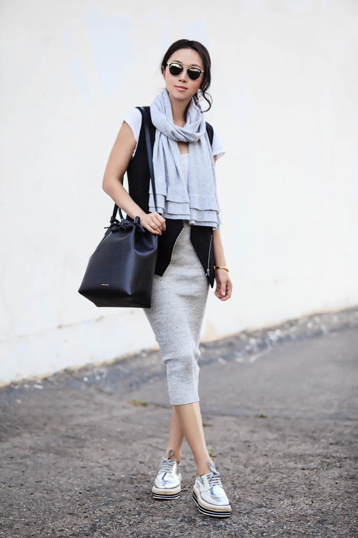 grey midi dress, a zip vest, a grey scarf and platform shoes