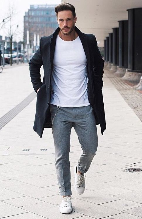 grey pants, a white tee, a black coat and white sneakers