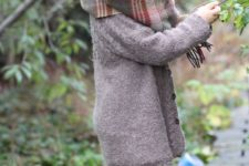 20 knit coat, striped leggings, fur boots, a plaid scarf and a knit hat