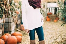20 white sweater, blue jeans, a burgundy scarf and brown high boots