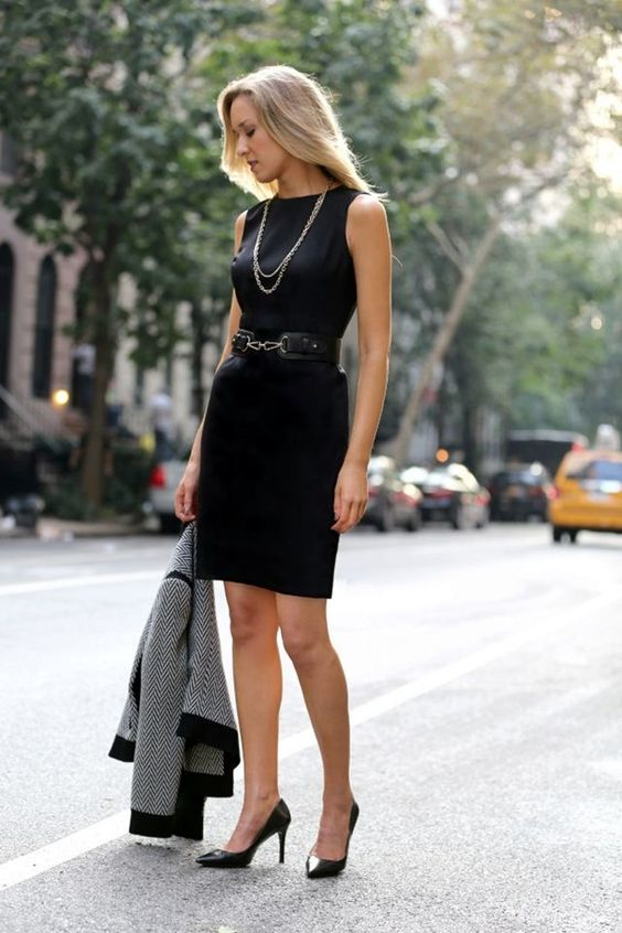 a little black dress with black shoes styled for an interview