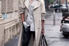 21 black pants, a grey shirt, high boots and a grey overcoat