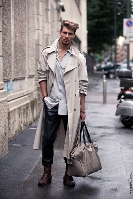 black pants, a grey shirt, high boots and a grey overcoat