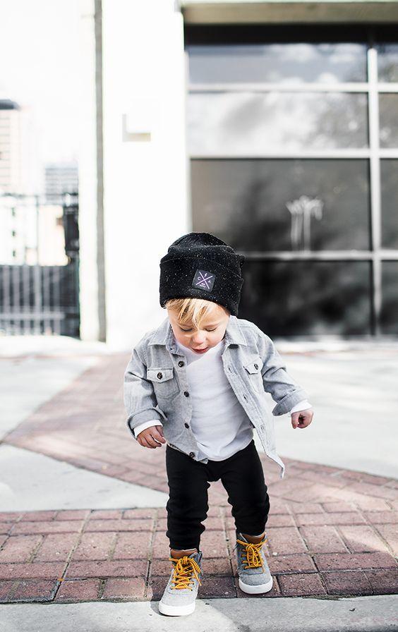 black trousers, a white tee, a denim shirt, grey chucks and a hat