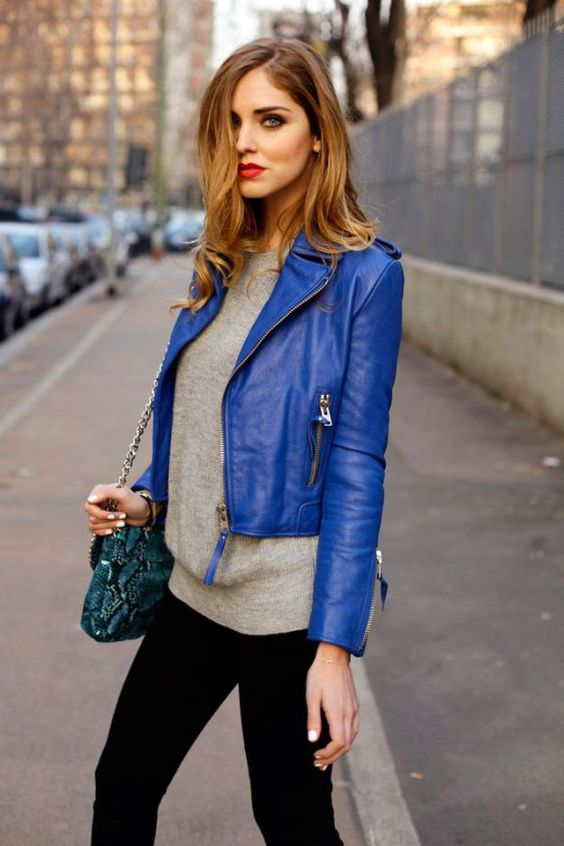 dazzling blue cropped jacket, a grey sweater and black jeans