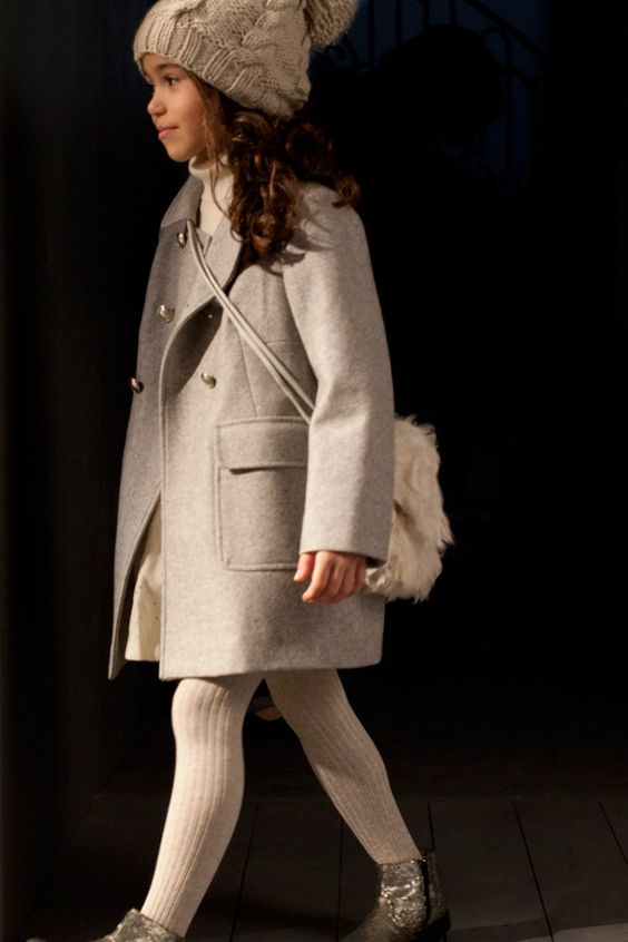 light grey coat, white tights, silver boots, a white hat