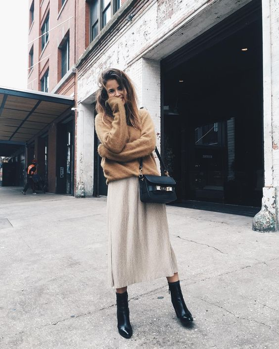 a grey midi skirt, a brown oversized jersey, black boots