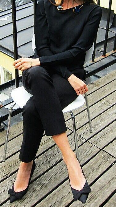 all-black look with trousers, sweater and bow flats